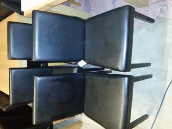 a set of four slightly used dinning chairs