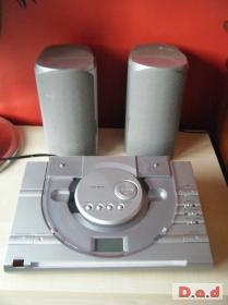 crown cd player and speakers. silver with blue light.