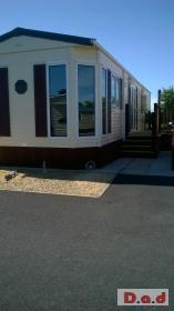 bk bluebird senetor static caravan with decking on 51 week site
