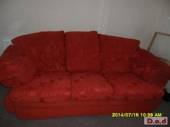 Red three seater sofa and matching chair